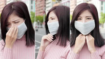 migrén : Vertical Video - woman feel headache and wear mask in the city