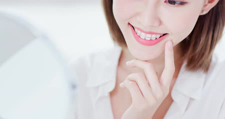 removable : Close up of Beauty woman wear retainer for teeth and look mirror happily