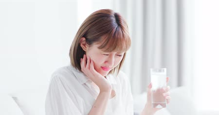 hassaslık : woman drink cold water with sensitive teeth and feel pain