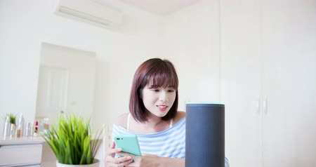 asistan : IOT AI smart home concept - woman talk with voice assistant to lturn on the air conditioner
