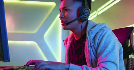 esports : Young Asian Handsome Pro Gamer win in Online Video Game