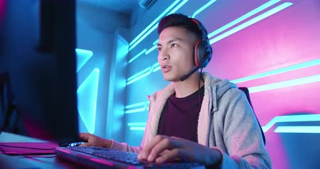 mmorpg : Young Asian Handsome Pro Gamer concentrate in playing Online Video Game