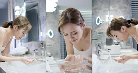 beleza e saúde : vertical slow motion of beauty asian woman wash her face at night