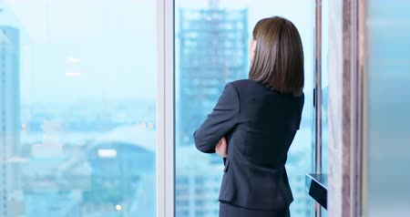 internar : businesswoman look outside through the windor and ponder