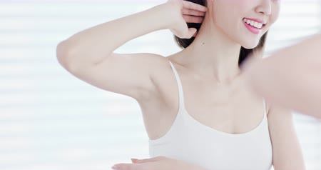 woman waxing : beauty woman smile happily with armpit - hair removal concept