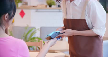 qr : mobile payment concept - In the Cafe Woman give Coffee to a Customer Who Pays by Contactless Phone to Credit Card System