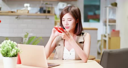 listens : Young woman work in cafe and use vocal assistant by phone - mobile office concept