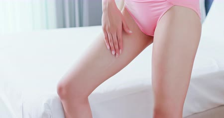 sunblock : Skin care concept - beauty woman apply cream onto her leg at home