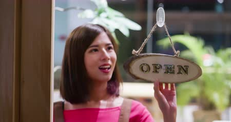 hang : Pretty girl closed up the cafe in the night Stock Footage