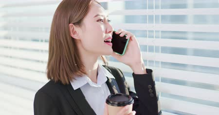 asistan : business woman speak smart phone happily in office