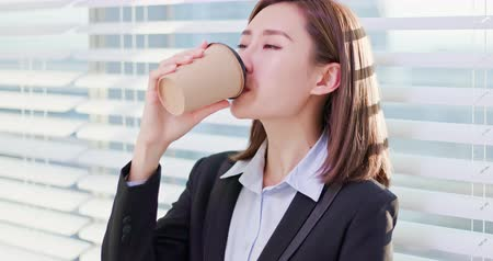 drinking coffee : business woman take a break and enjoy good coffee in the office