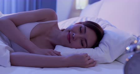 dark eyes : beauty asian woman has a good sleep on the bed at night