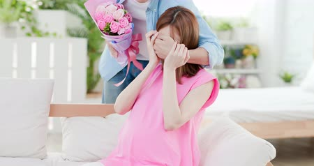 hiding : Happy mother day - sweet man send flower to his wife which is pregnant Stock Footage
