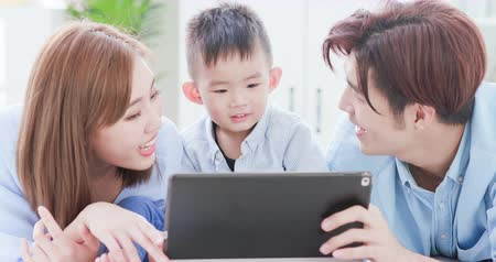 ski : Parent play with child by tablet at home