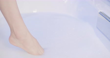 coxa : slow motion of woman step into the bathtub at night