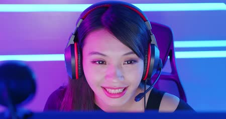 esports : Young Asian Pretty Pro Gamer having live stream and playing in Online Video Game