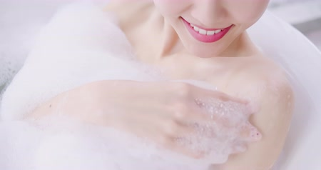 seio : slow motion of asian woman taking a bubble bath in the bathroom