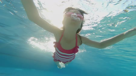 plavat : cute girl swim in the swimming pool