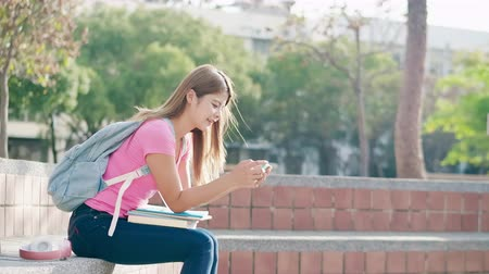 sırt çantasıyla : asian student play game with smart phone and win