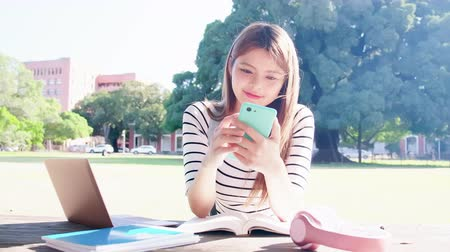 sturen : asian student use the smart phone in the school