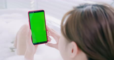 película de filme : woman take a smart phone with green screen while bathing Stock Footage