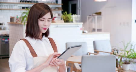 bakkal : pretty young asian woman use pad to order meal
