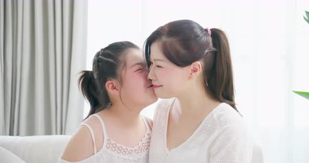csók : slow motion - daughter kiss her mom tenderly and smile happily