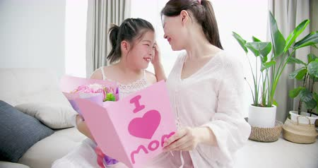 livingroom : slow motion - daughter give card and gift to her mom
