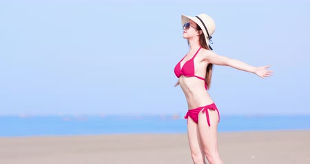 suntan : summer sunblock concept - beauty asian woman enjoy the sunshine Stock Footage