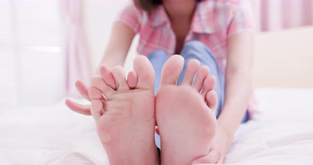 toes : asia woman itching her athlete foot with health concept