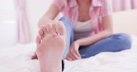 psoriasis : woman applying cream for athletes foot treatment
