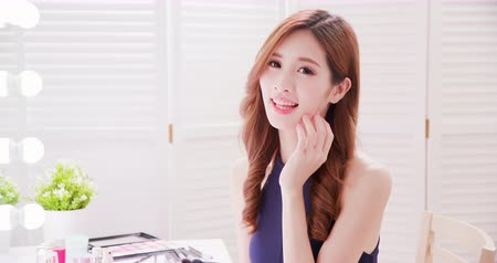 hand on chin : beauty asian woman makeup happily with health skin and smile to you