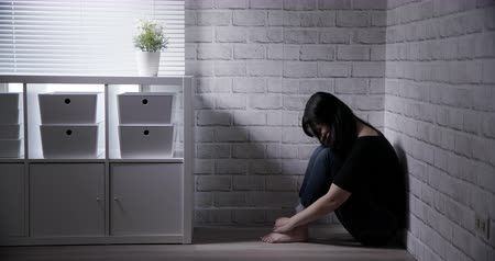 desamparado : Asian woman feel depressed in the corner