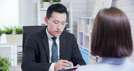 man in office : confident asian woman talk to interviewer for a job interview