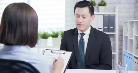 dava : unconfident asian man talk to female interviewer for a job interview