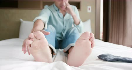 itch : man scratch the itch by hand with athlete foot problem in the room