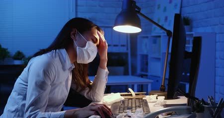migrén : asian woman overtime work along and feel tired in the office Stock mozgókép