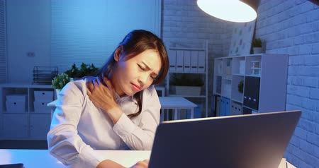 disappointment : asian woman overtime work and feel shoulder pain in the office