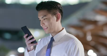 taipei : businessman use phone outdoor in the evening Stock Footage