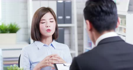 meetings : confident asian woman talk to interviewer for a job interview