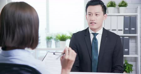 stagiair : confident asian man talk to female interviewer for a job interview
