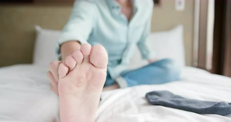 psoriasis : man scratch the itch by hand with athlete foot problem in the room