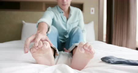the inflammation : man scratch the itch by hand with athlete foot problem in the room