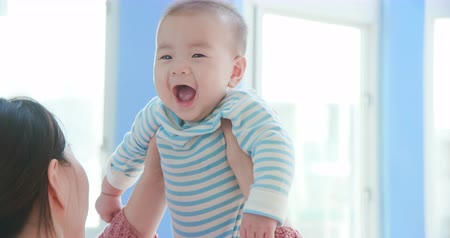 baby infant : asian mother play with her baby happily at home Stock Footage