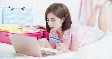 caso : Asian beauty plan for trip by laptop and credit card
