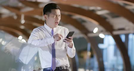 fire suit : businessman use the phone and feel upset Stock Footage