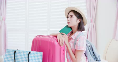 ケース : Asian beauty ready for travel with suitcase and passport