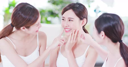 make friends : asian women friend are talking about thier healthy skin and teeth
