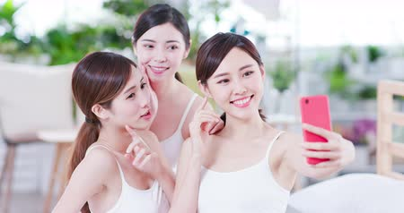 make friends : Smiling asian womans take selfie after the skin care in the spa salon