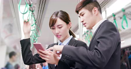public worker : Asian Business people use smart phone on the mrt